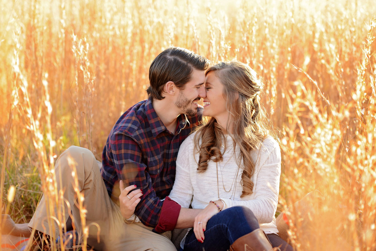 cuddled field engagement session in Huntsville al