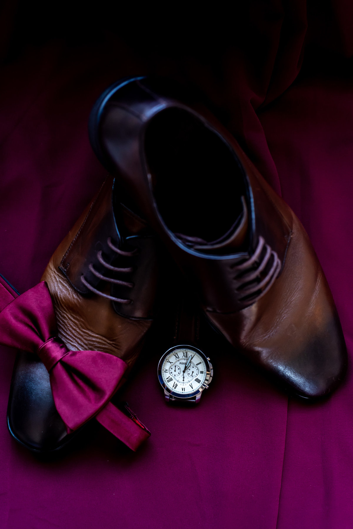 Bold wedding photo with a grooms' shoes and accessories.