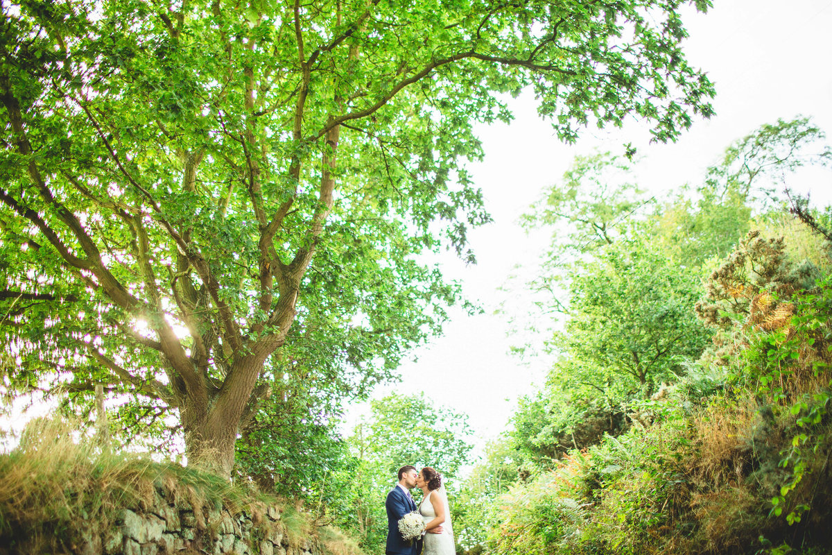 creative wedding photo of bride and groom kissing