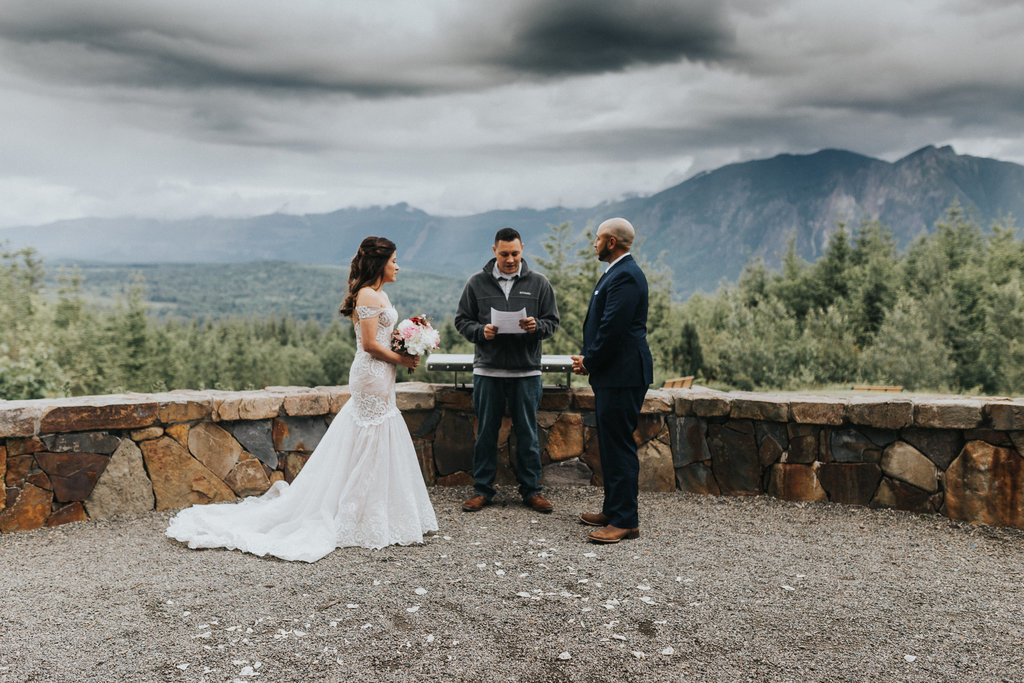 An elopement couple say their vows in this mountaintop elopement in Mt. Rainier, Washington.