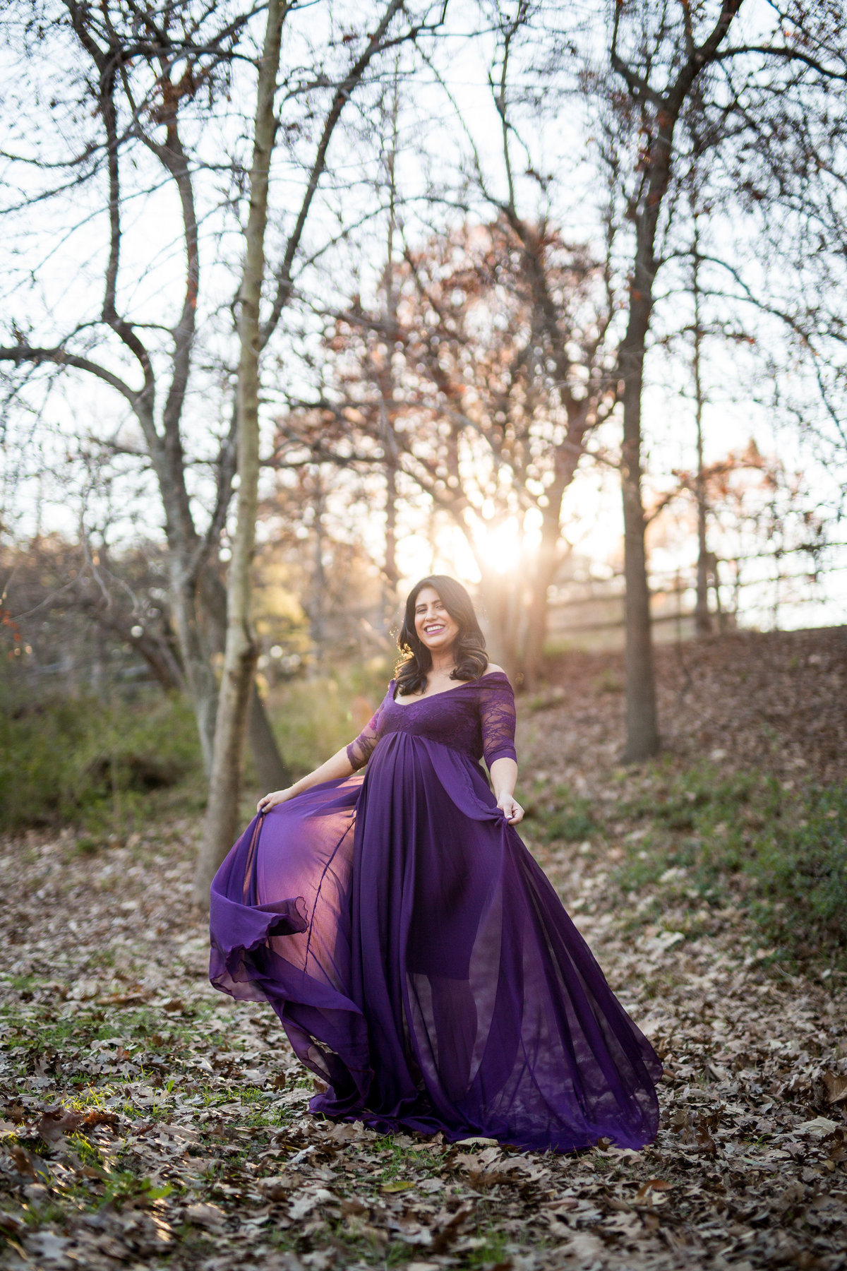 woman in purple maternity dress at sunset for her photography session at Denman Estate Park in San Antonio