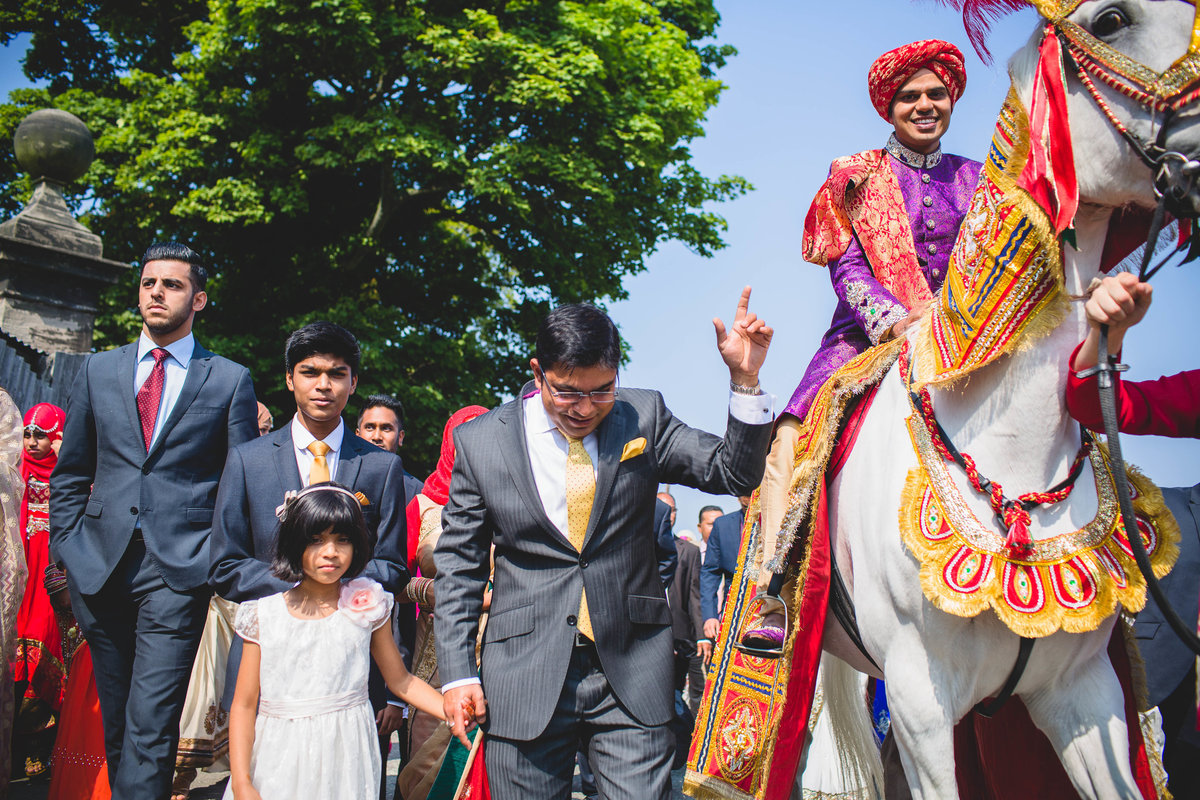 asian wedding groom horse thornton manor
