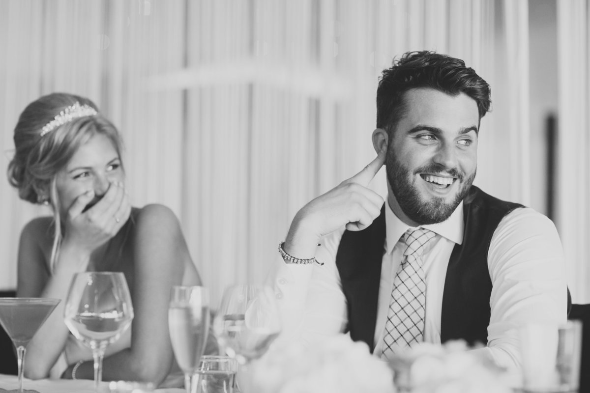bride and groom laughing in speeches