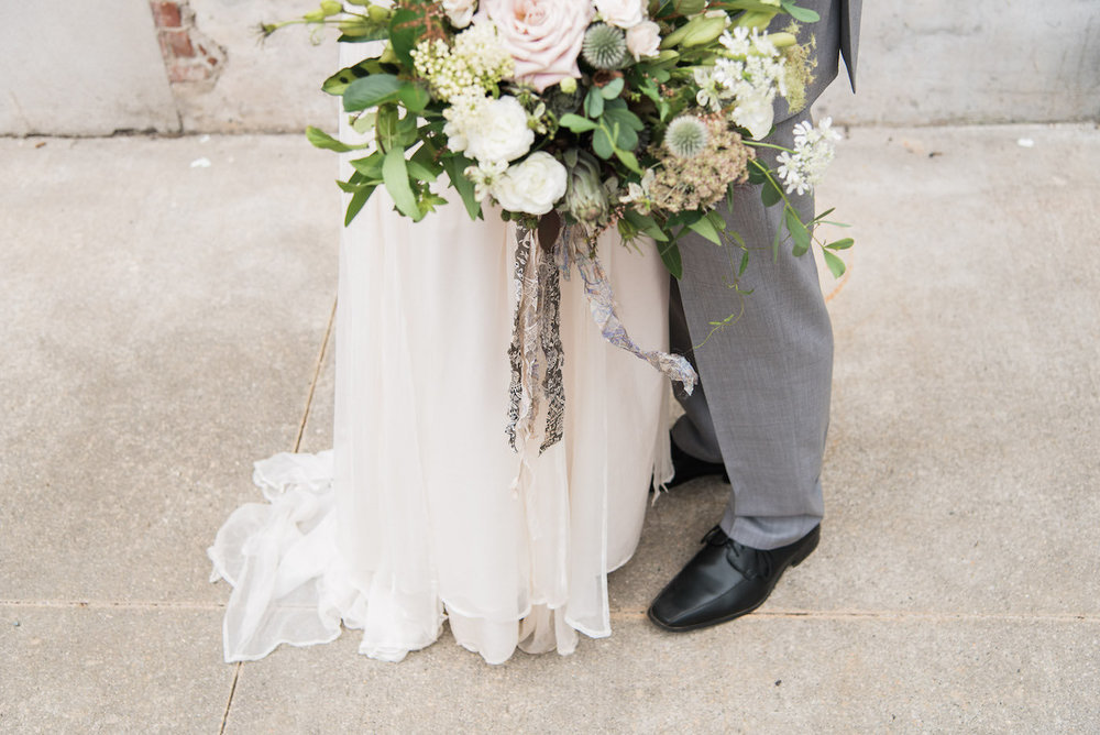 close up of bride groom and bouquet