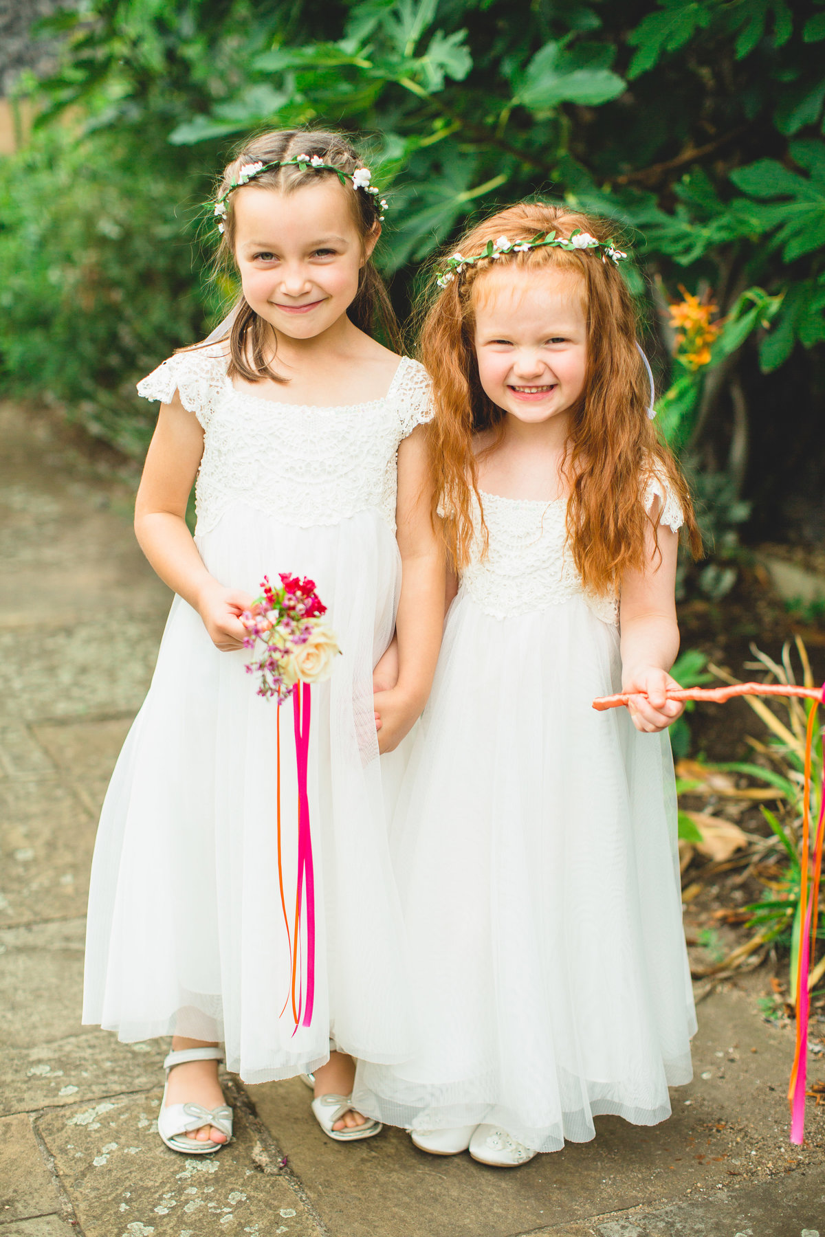 cute flower girls with wants and ribbons