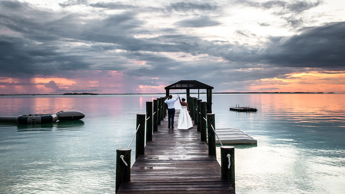Destination-Wedding-Bride-and-Groom-on-Dock-Harbour-Island-Bahamas