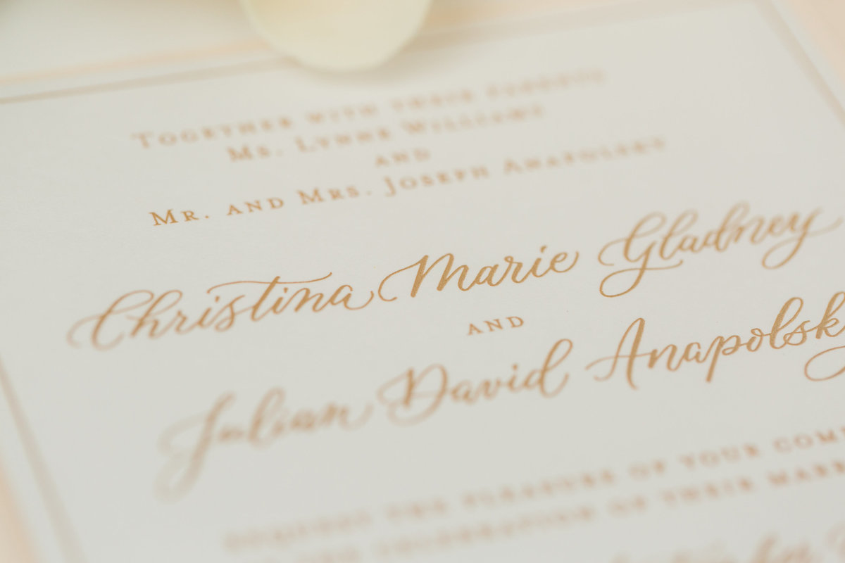 Goldink closeup of wedding invitations