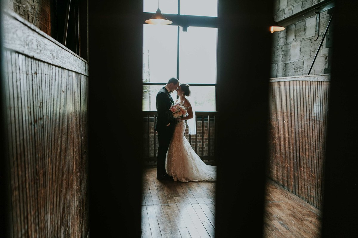 Bride and groom spend alone time in room at bIltwell center