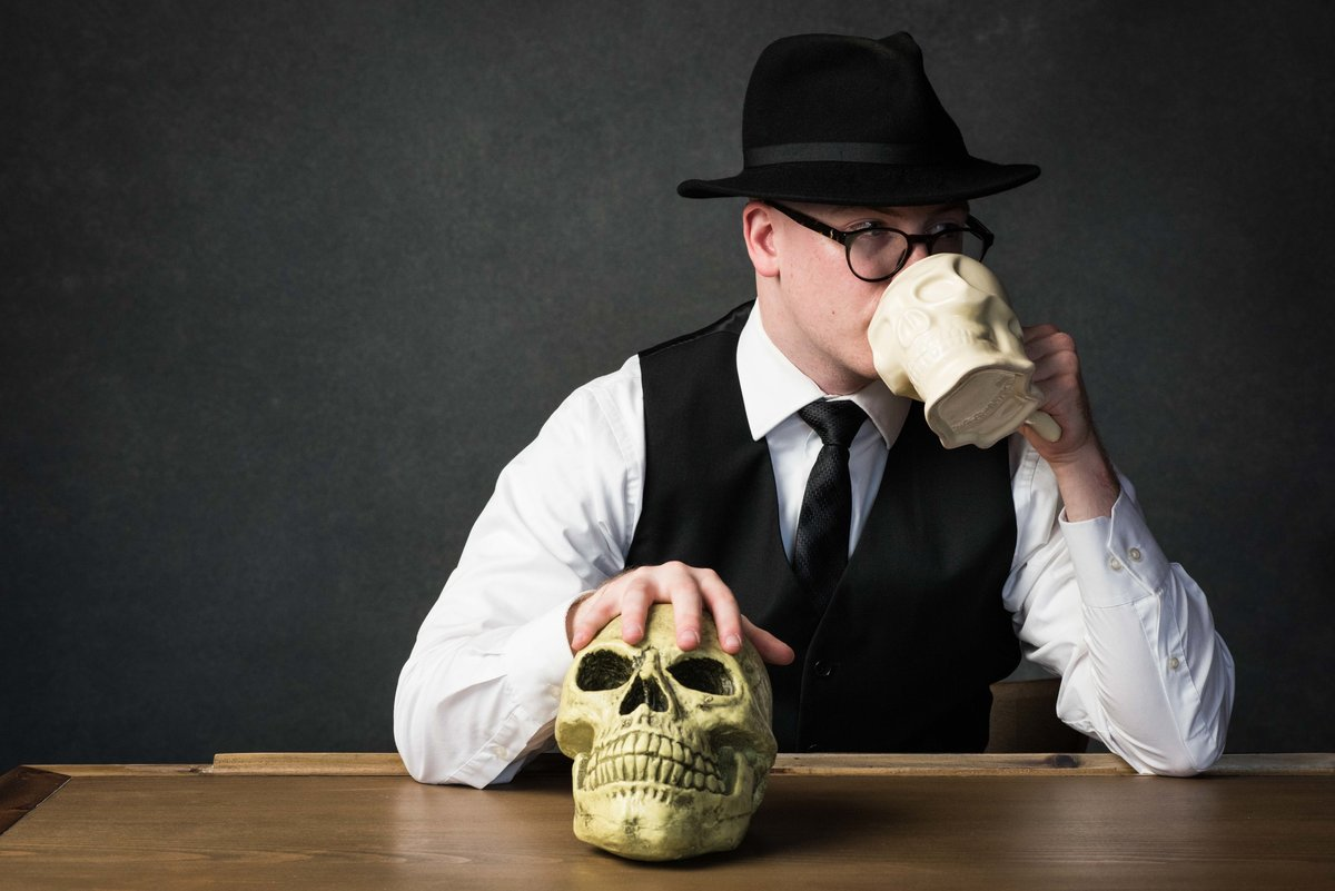 Author portrait, male author Chicago, with skulls.