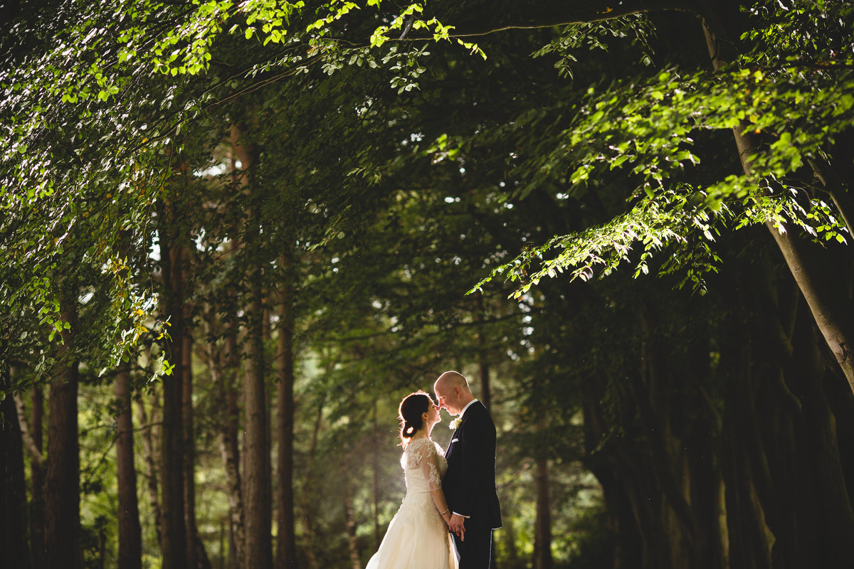 a backlit photo of the bride and groom taken at nunsmere hall