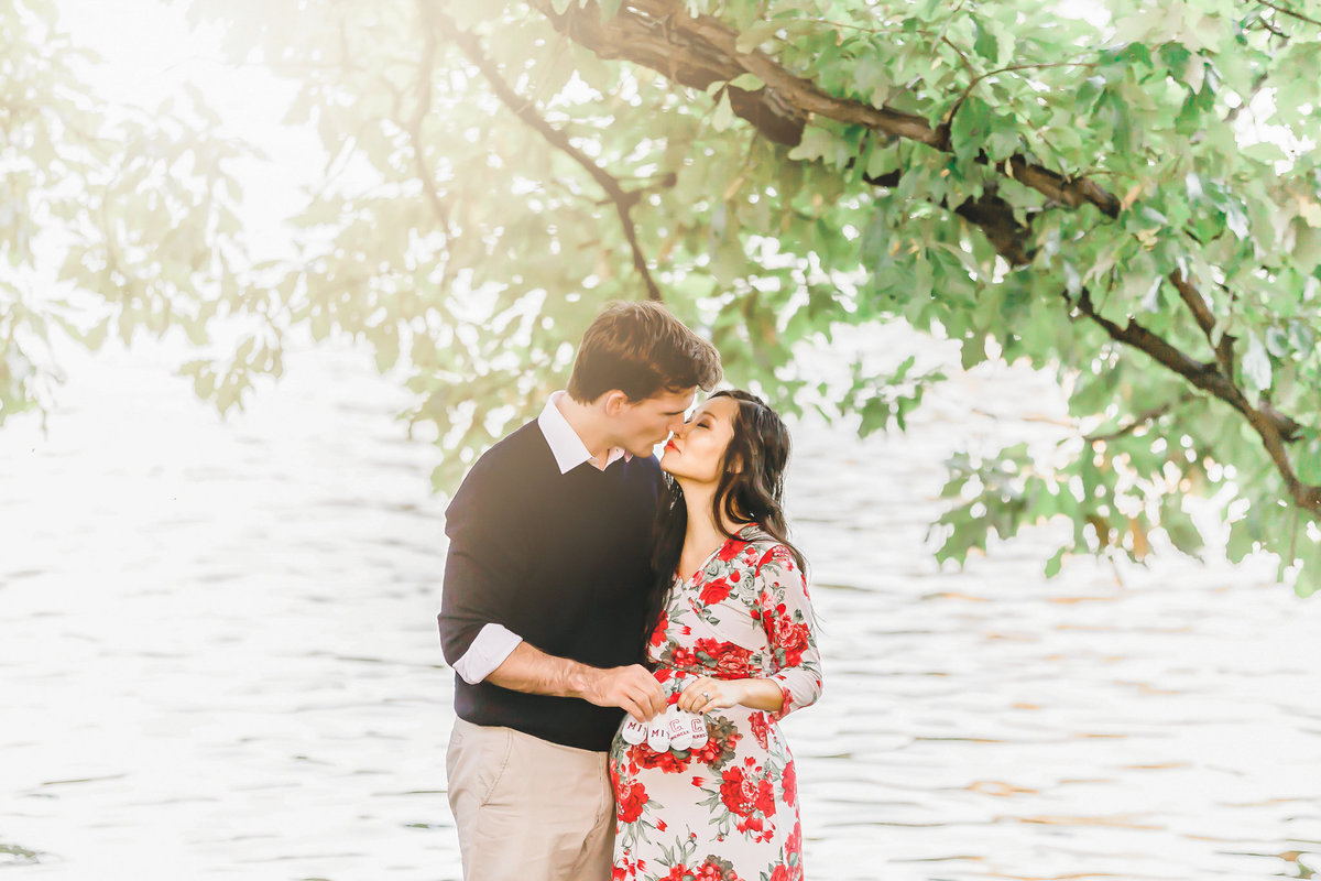 Dreamcatcher Rose Studios - manhattan - maternity - kissing by lake under trees