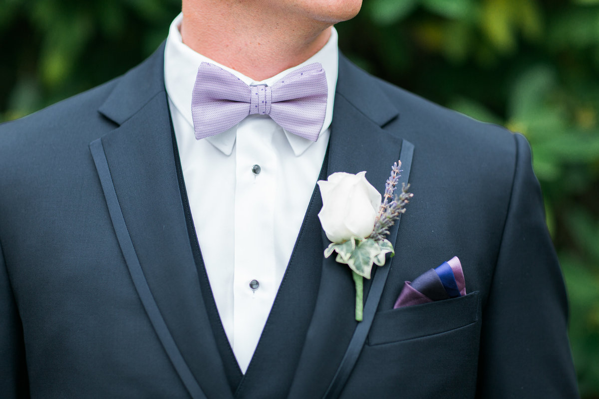 Groom wearing lavender bowtie and boutonniere Bastyr Univeristy Chapel Hollywood Schoolhouse Woodinville