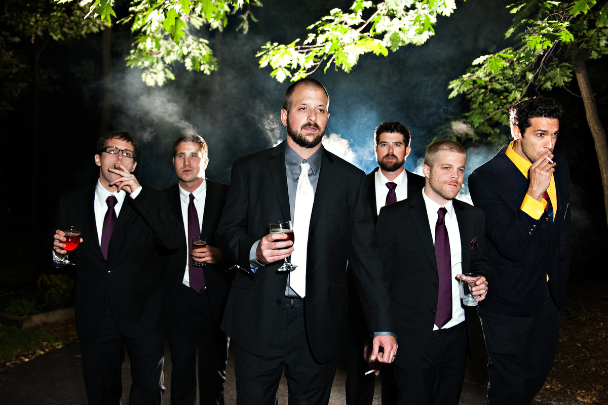 A groom and his groomsmen smoke cigars after this beautiful Lehigh Valley Wedding.