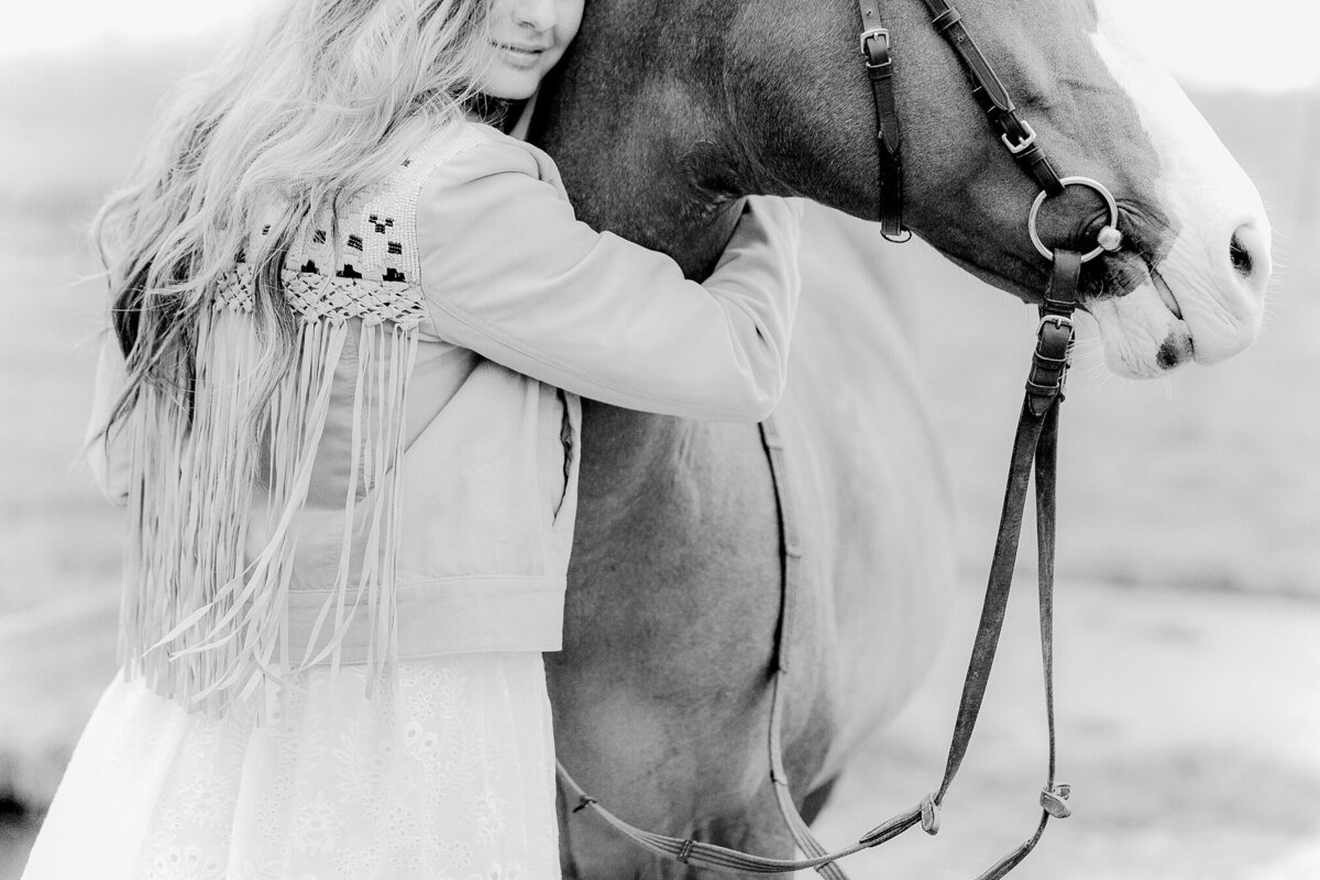 girl hugging her horse