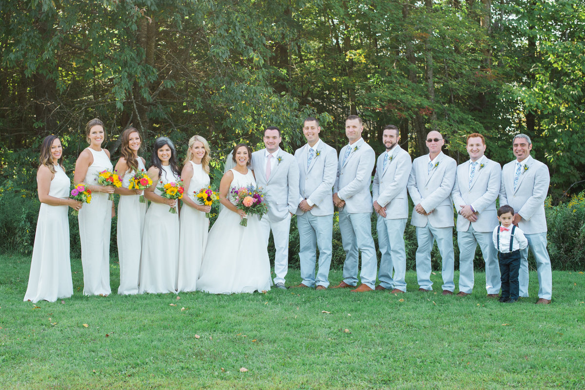 bridal party in gray and white, bridesmaids in pantsuits