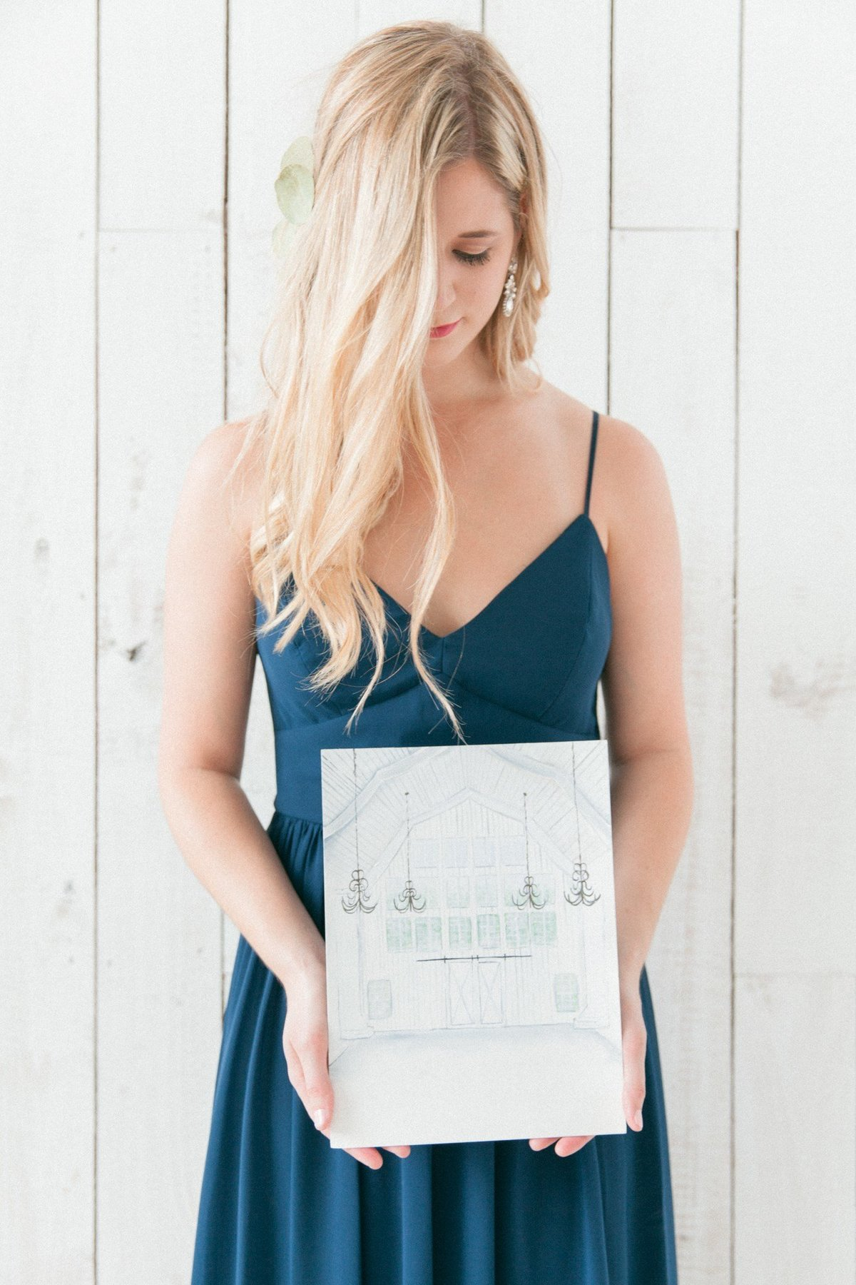 Blonde model holding White Sparrow Quinlan Texas DFW Watercolor Wedding Invitation Suite