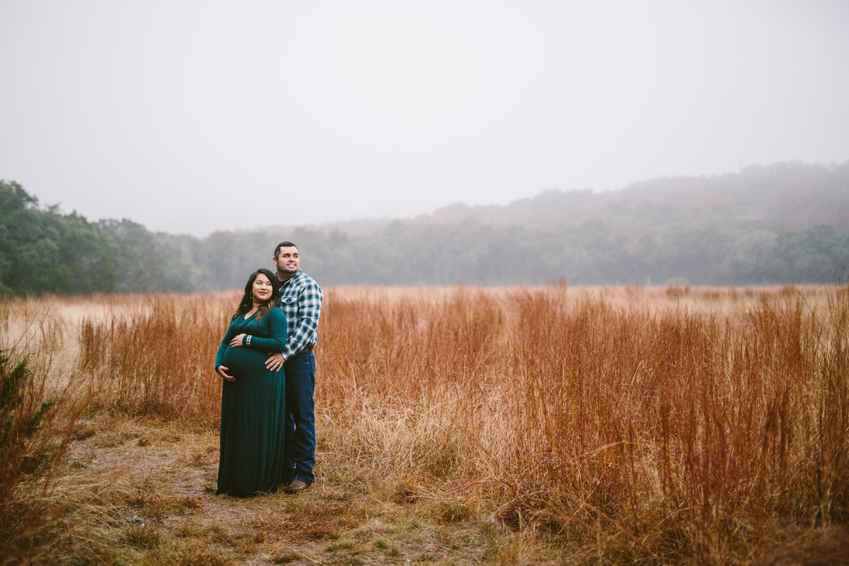 Maternity session of couple in field in the Texas hill country.