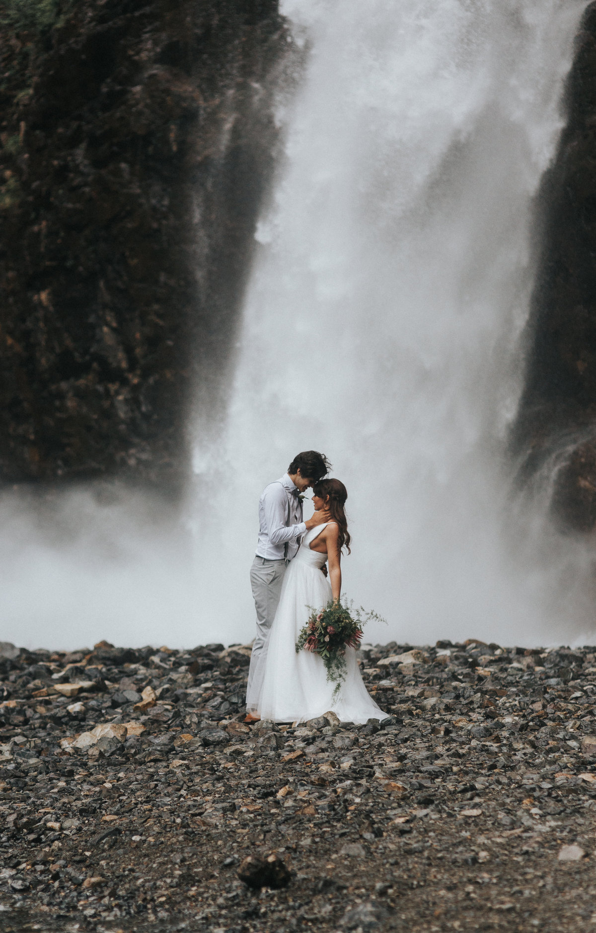 Waterfall portrait of a bride and groom in Seattle, Washington.