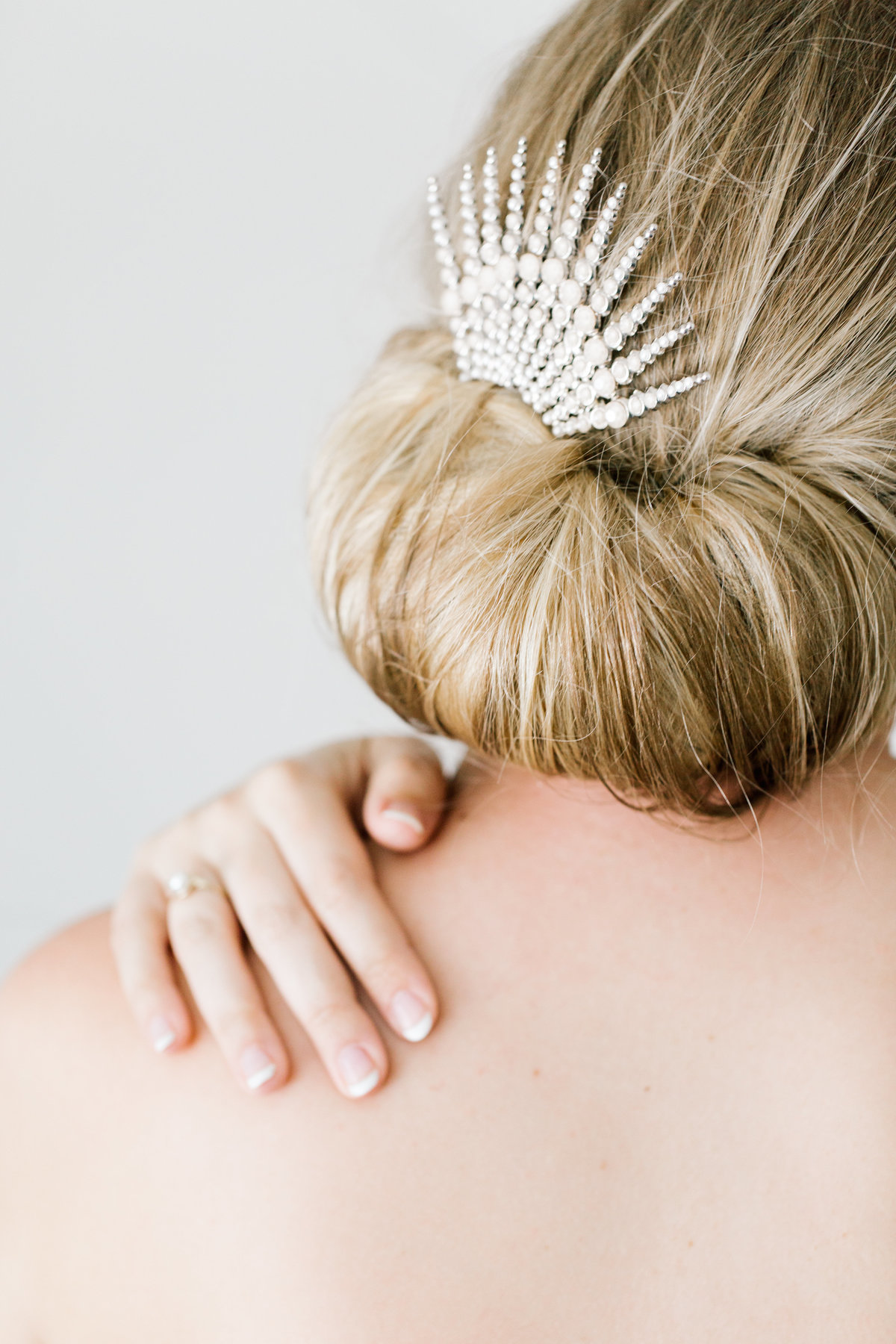 bride hair clip and hand on shoulder
