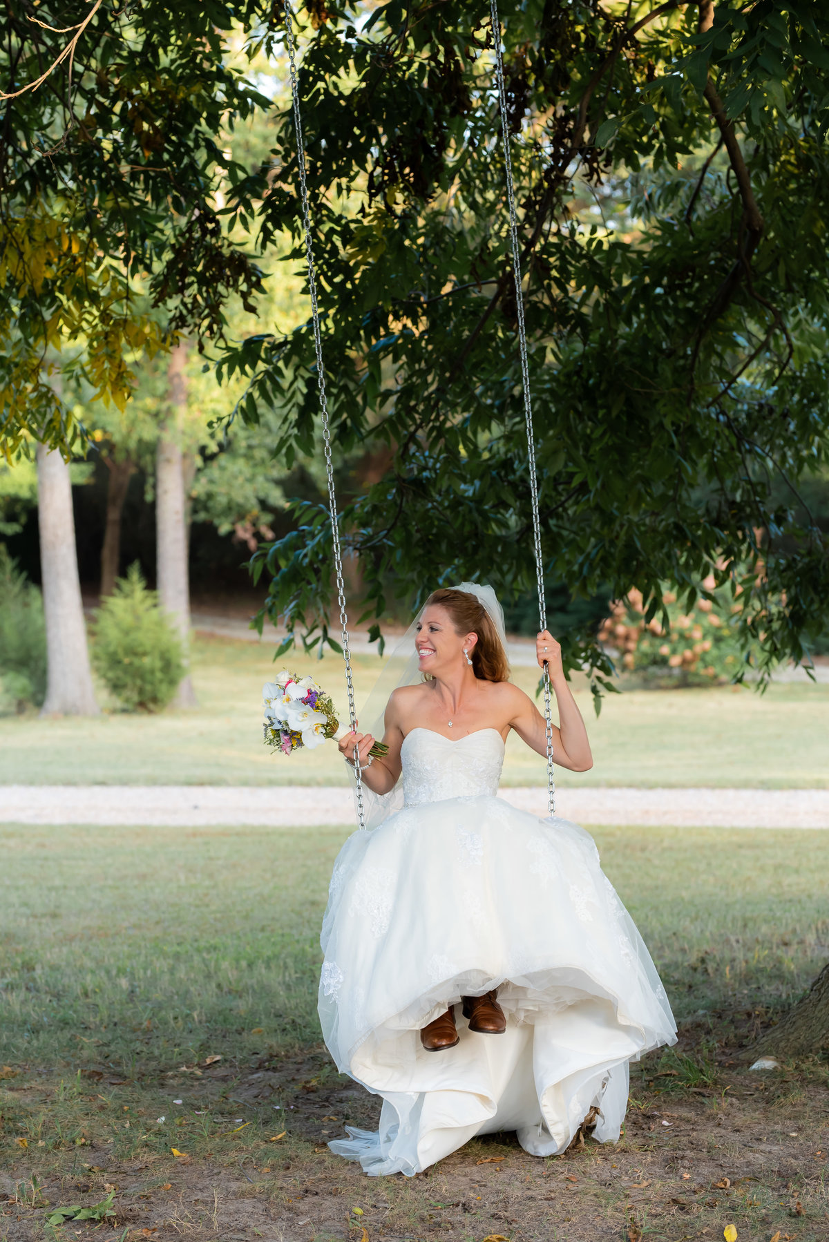 Bride on a swing. Richmond  wedding photographers.