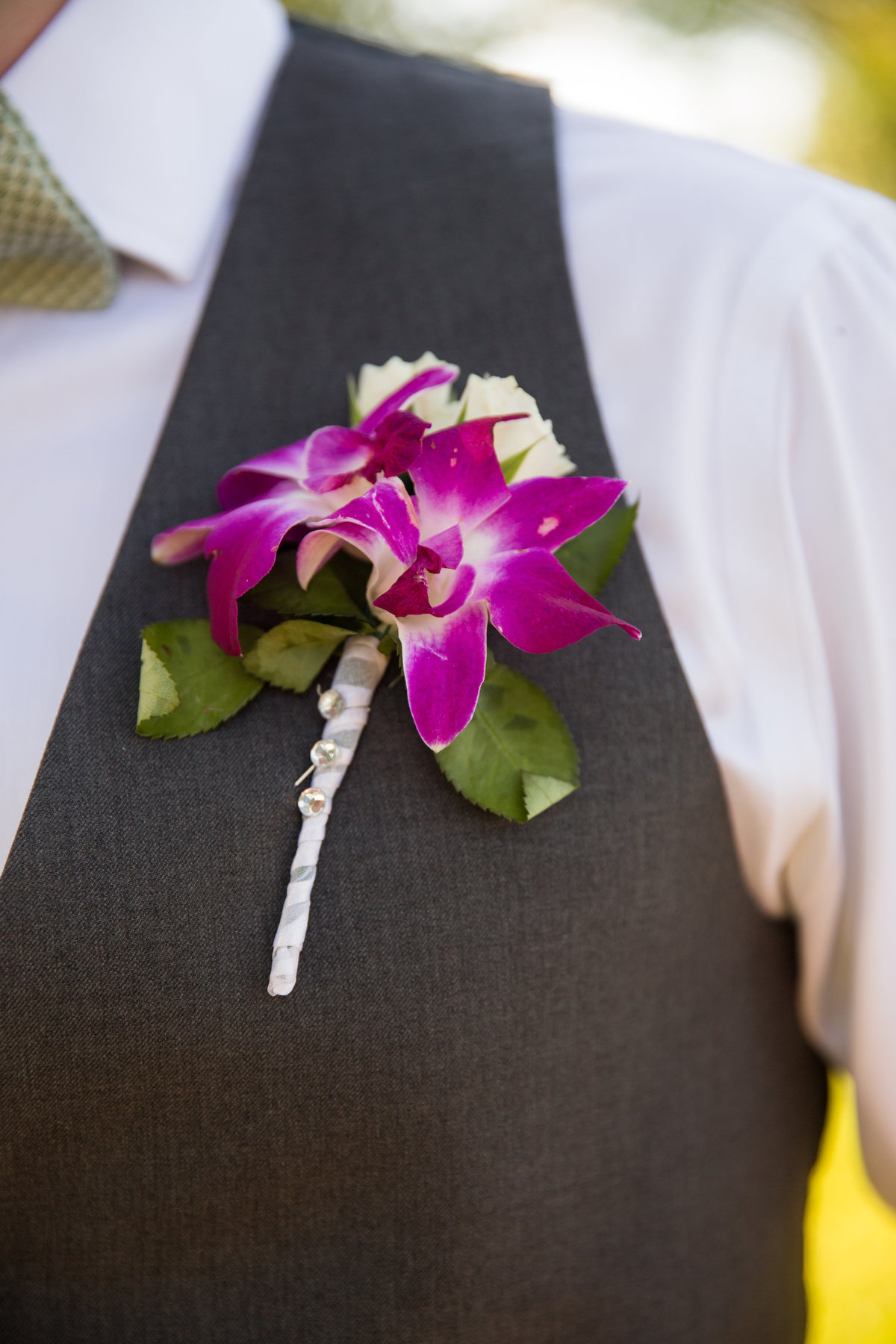 River Rock Event Center Texas Groom Boutonniere pink orchid