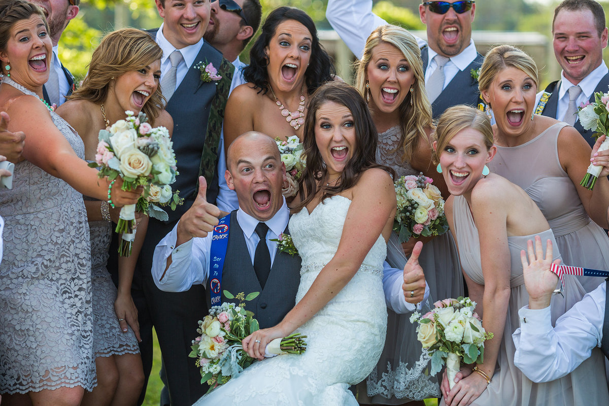 laughing and cheering bridal party at williams tree farm