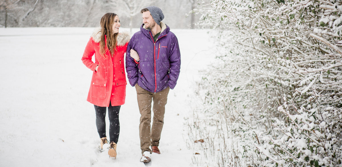 Walking along the tree line in the snow by Knoxville Wedding Photographer, Amanda May Photos.