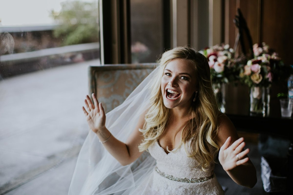 Bride shows excitement before rooftop wedding at Regions Tower JPS Events
