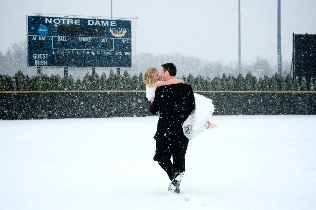 Snow falls on the Bride and Groom at Frank Eck Baseball Stadium, Notre Dame, IN