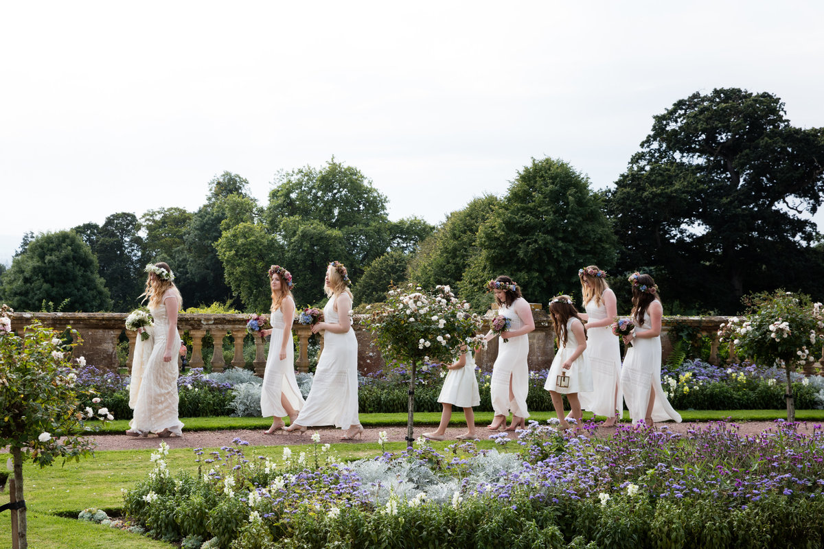 bridal party walking in the gardens at hestercombe