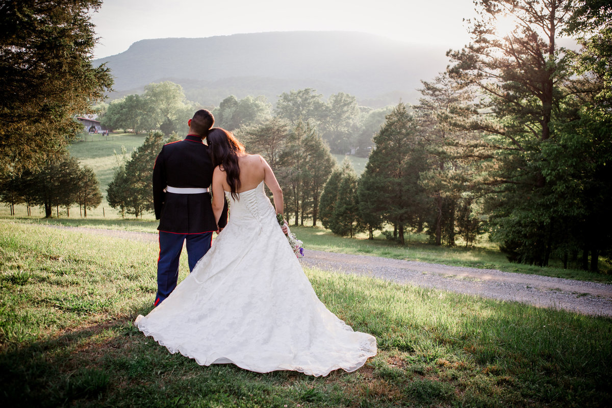 Bride lays her head on her groom's shoulder looking at the mountains at the barn at highpoint farms by Knoxville Wedding Photographer, Amanda May Photos.