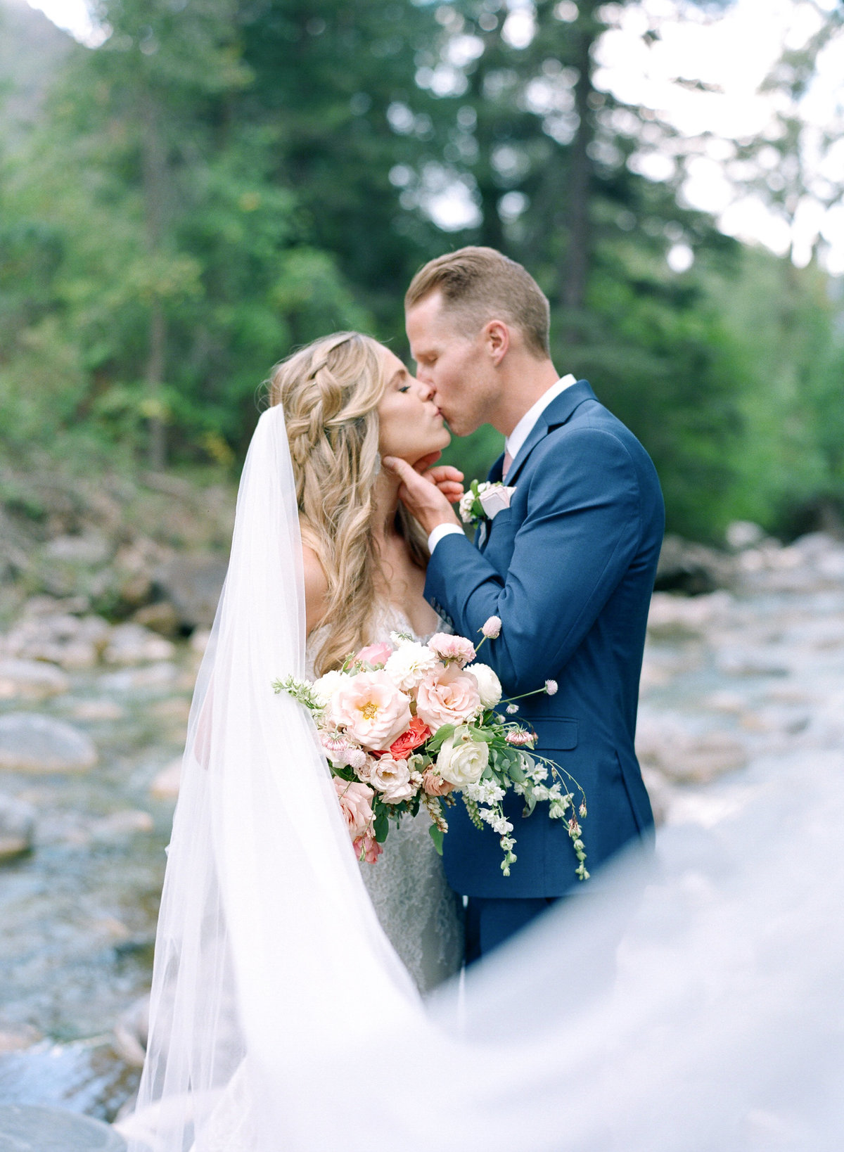 Aspen Wedding Photographer bride and groom on creek
