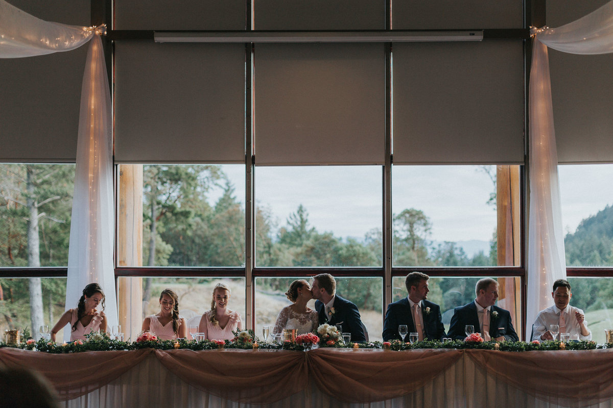 Bride and groom at the end table with their wedding party Olympic View Golf Course wedding Victoria BC