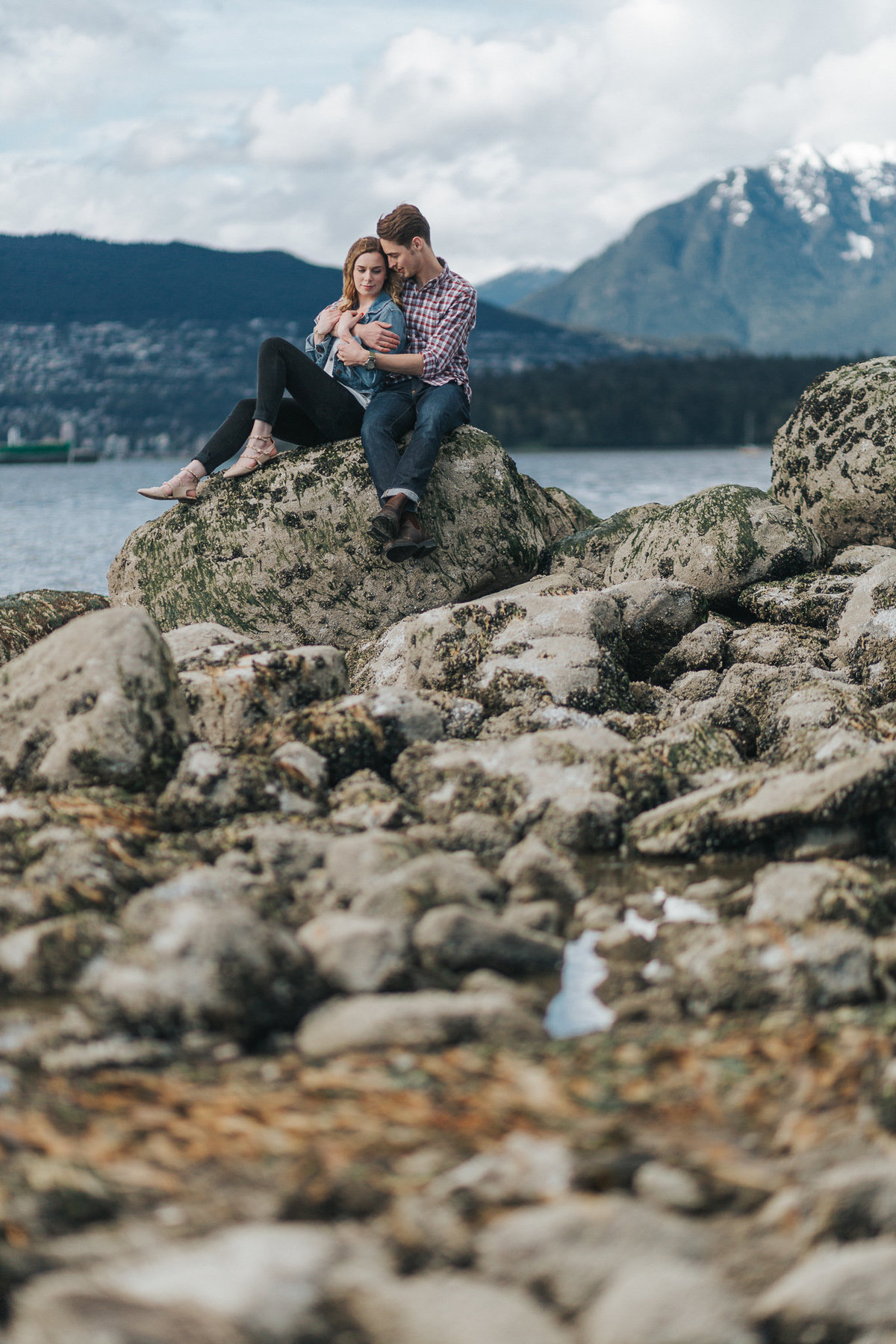 Future bride and groom sharing an intimate moment at Kitsilano Beach in Vancouver, BC