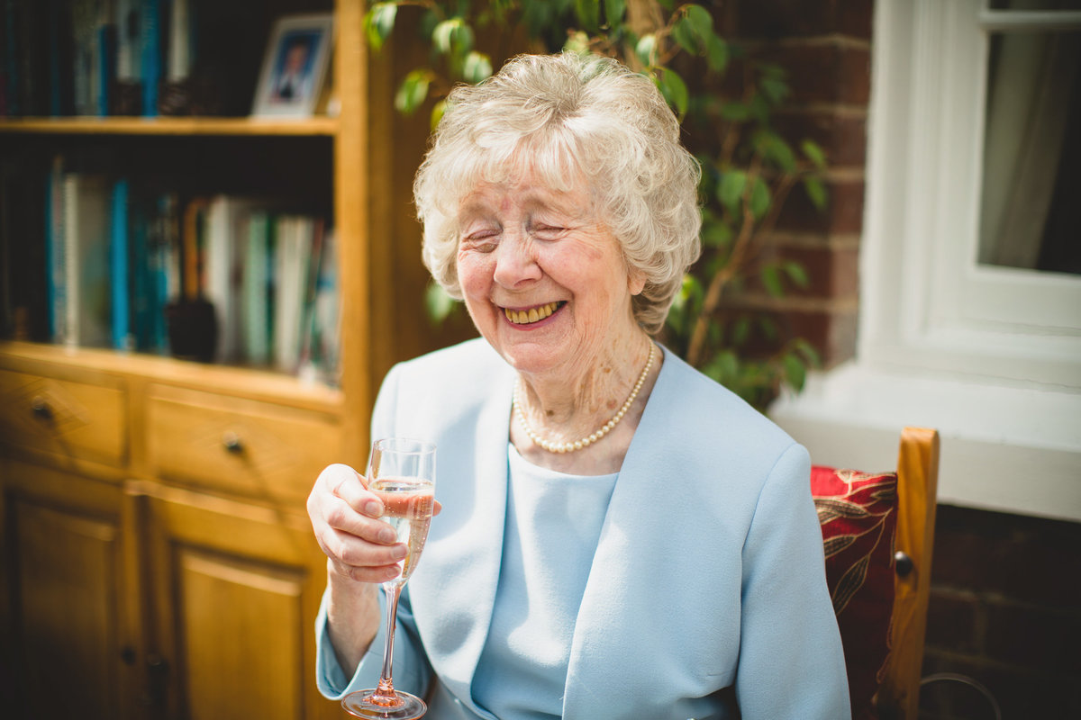 brides nanna drinking champagne on morning of wedding