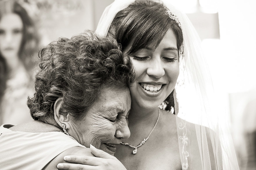 The bride gets a hug from her grandmother before her wedding in Champaign/Urbana.