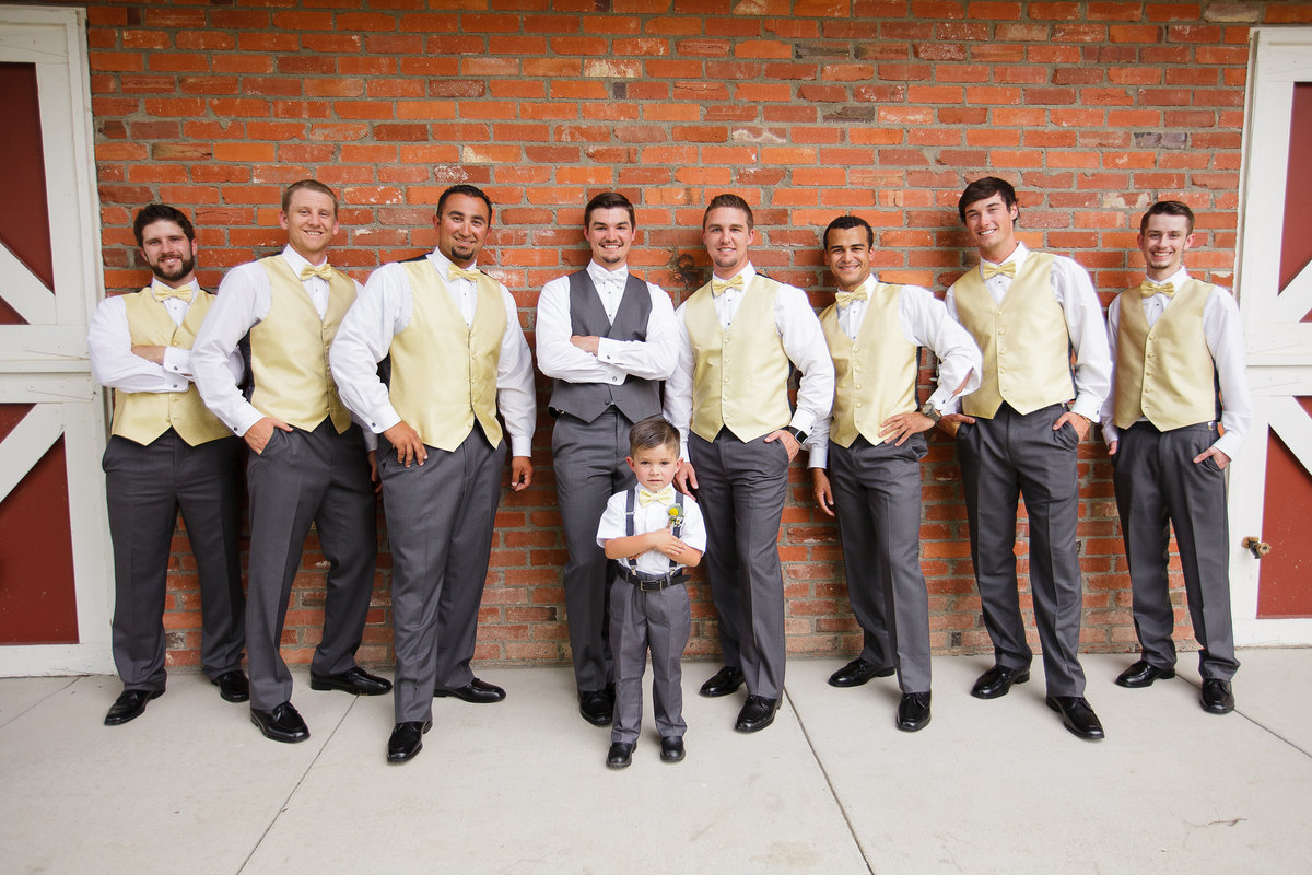 yellow-and-grey-colors-groom-with-groomsmen-Colorado-wedding