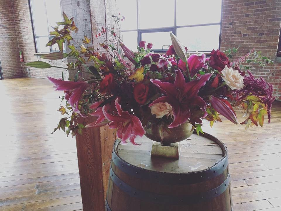 burgundy and pink ceremony arrangement