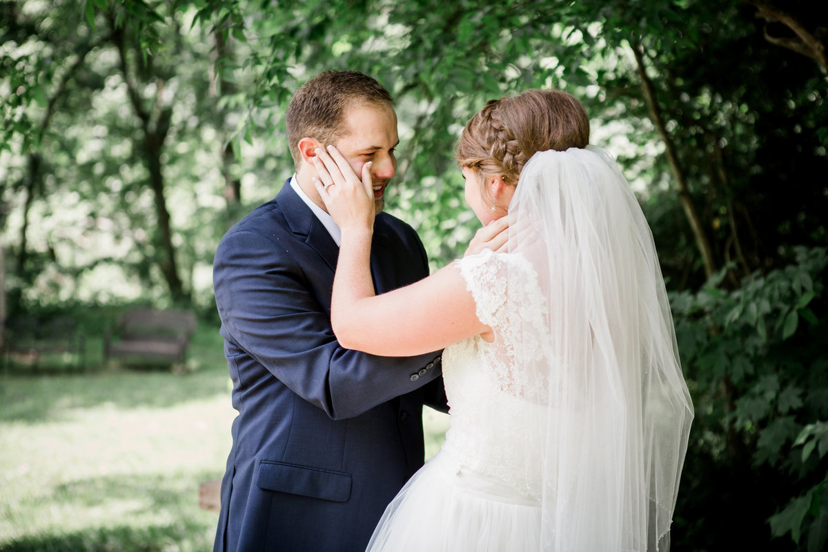 Bride wipes away groom's tears during first look at Cason's Cove Wedding Venue by Knoxville Wedding Photographer, Amanda May Photos.