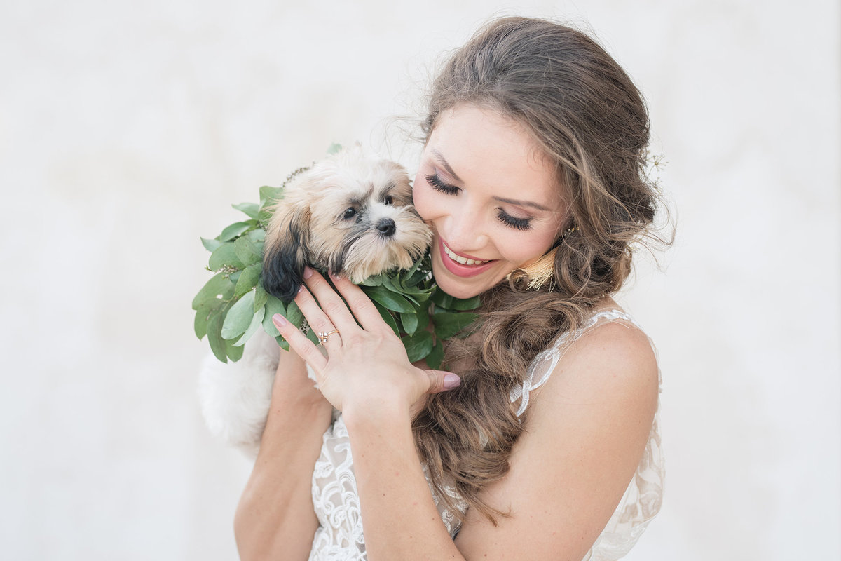 Bride holds puppy at Villa Antonia Bridal Session