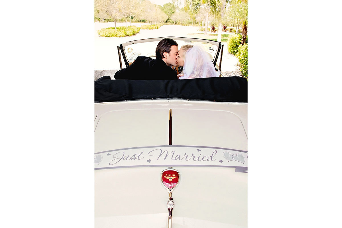 classic jaguar just married sign on car wedding