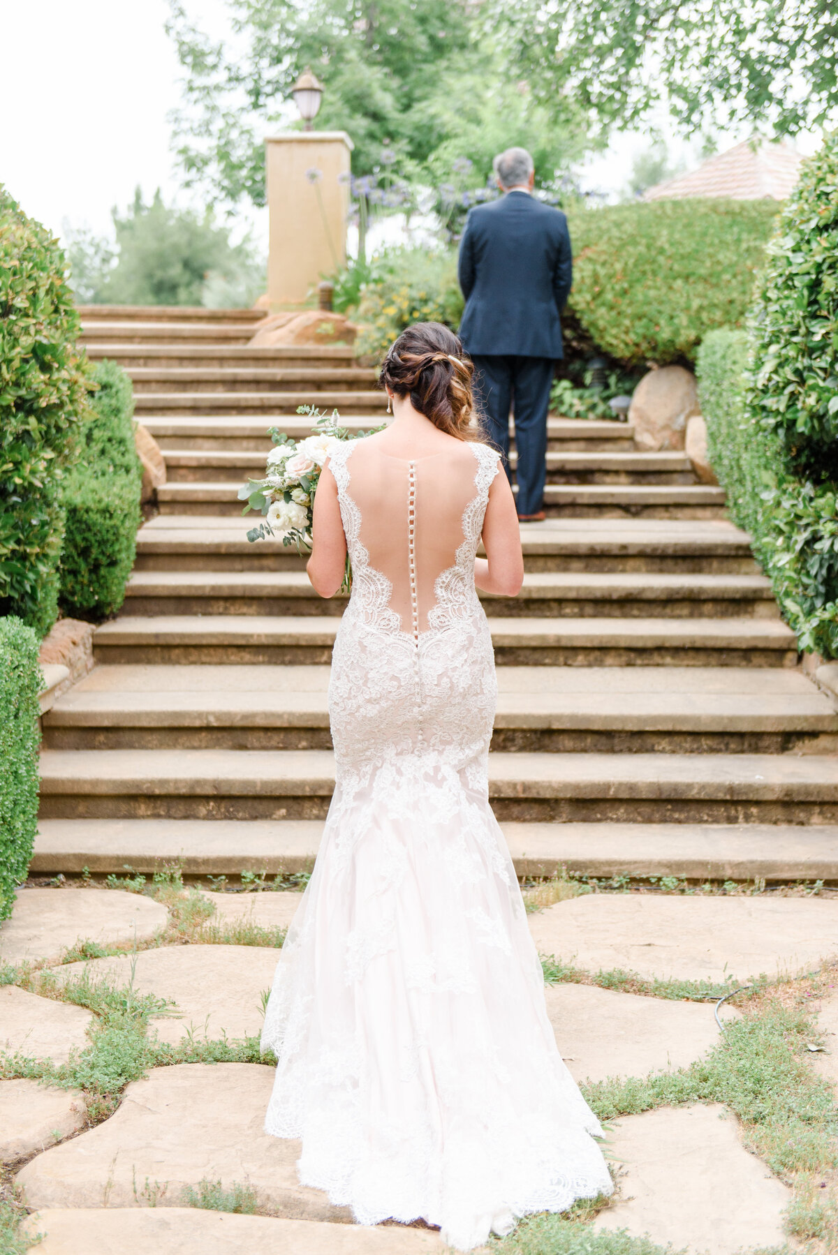 a bride and groom on long staircase