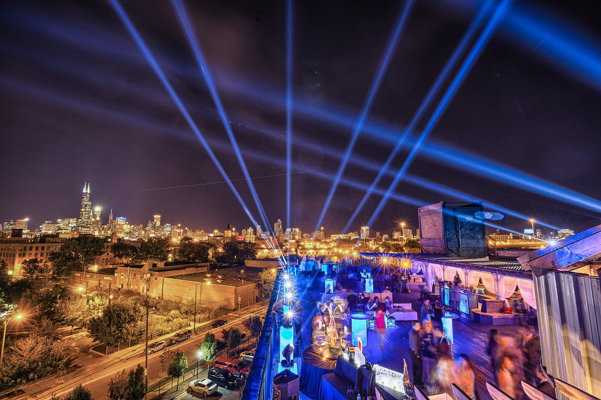 rootop event in chicago with beams of light
