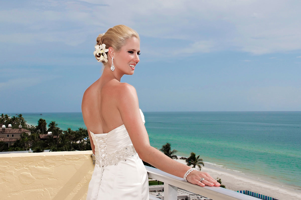 naples beach hotel and golf club wedding bride on balcony