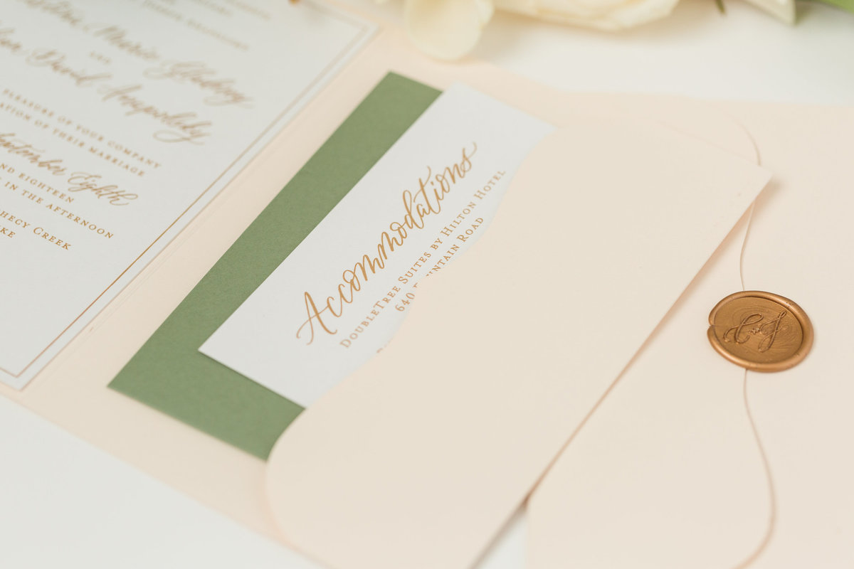 Gold and green wedding invitations with custom hand lettering