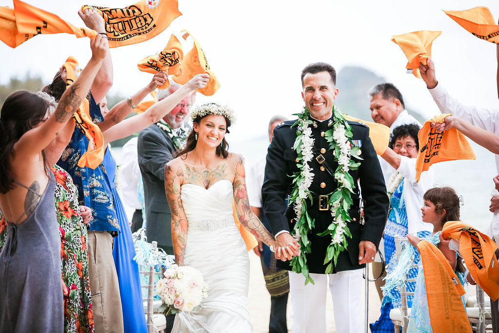 Guests wave terrible towels as couple walks down the aisle
