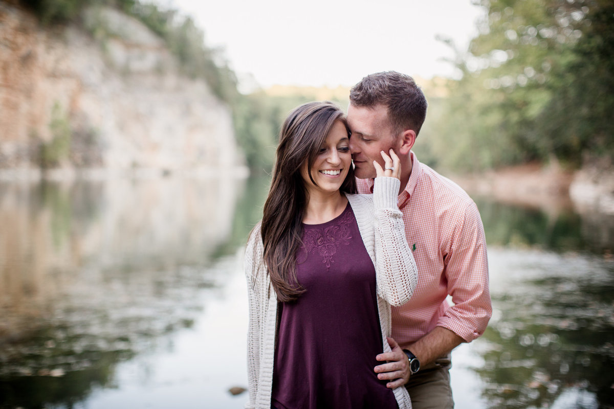 Standing in front of Meads Quarry water engagement photo by Knoxville Wedding Photographer, Amanda May Photos.