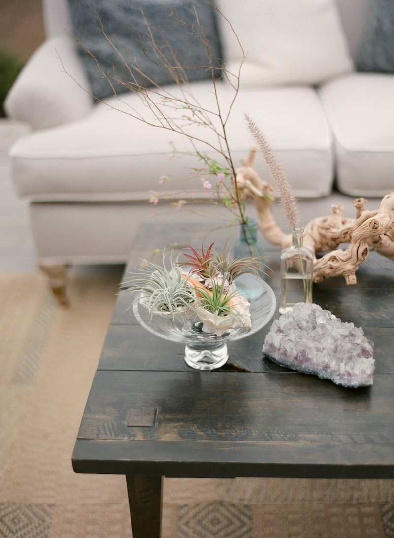 beach items styled on coffee table