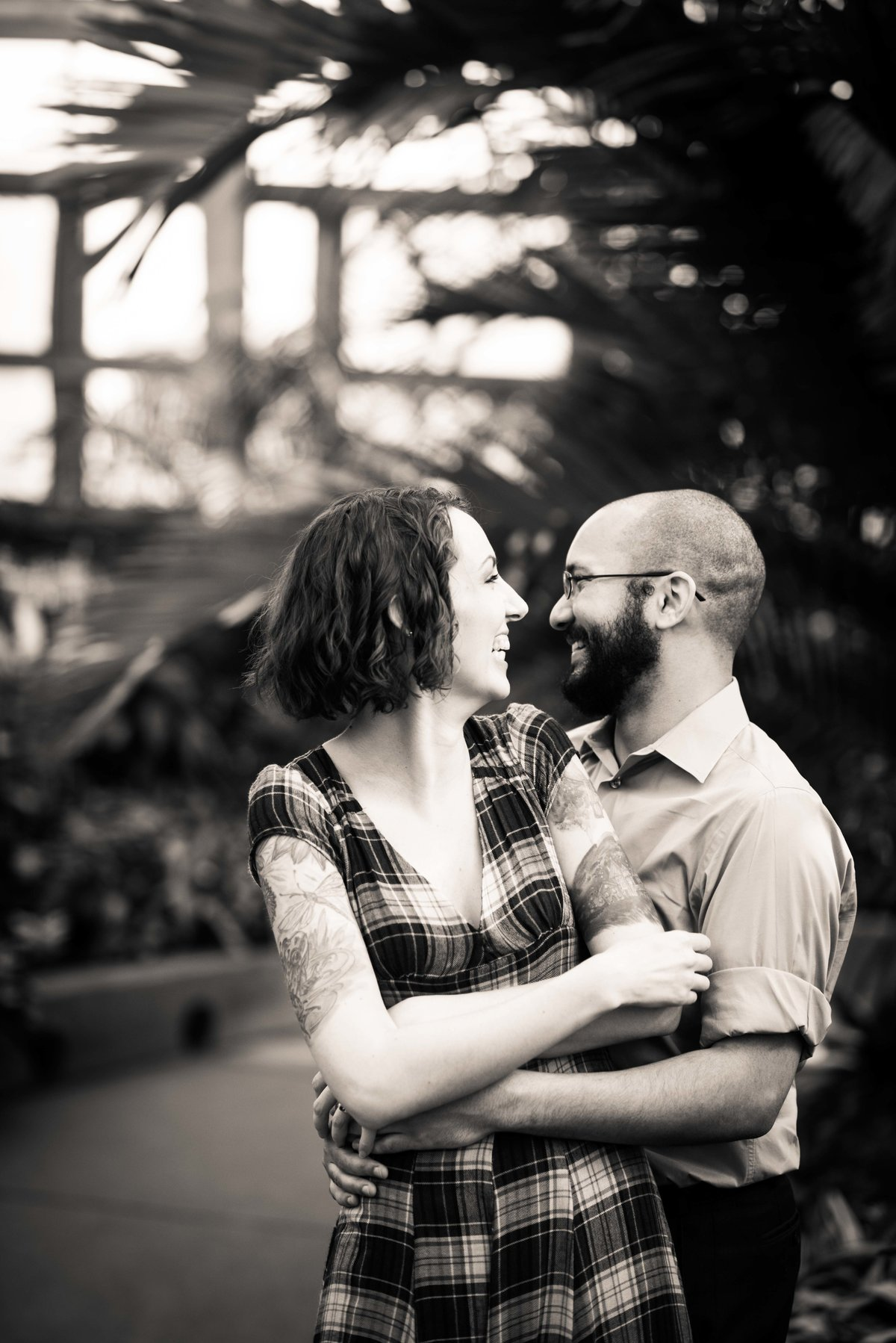 Engaged couple smiles and laughs, Garfield Park Conservatory, Chicago.