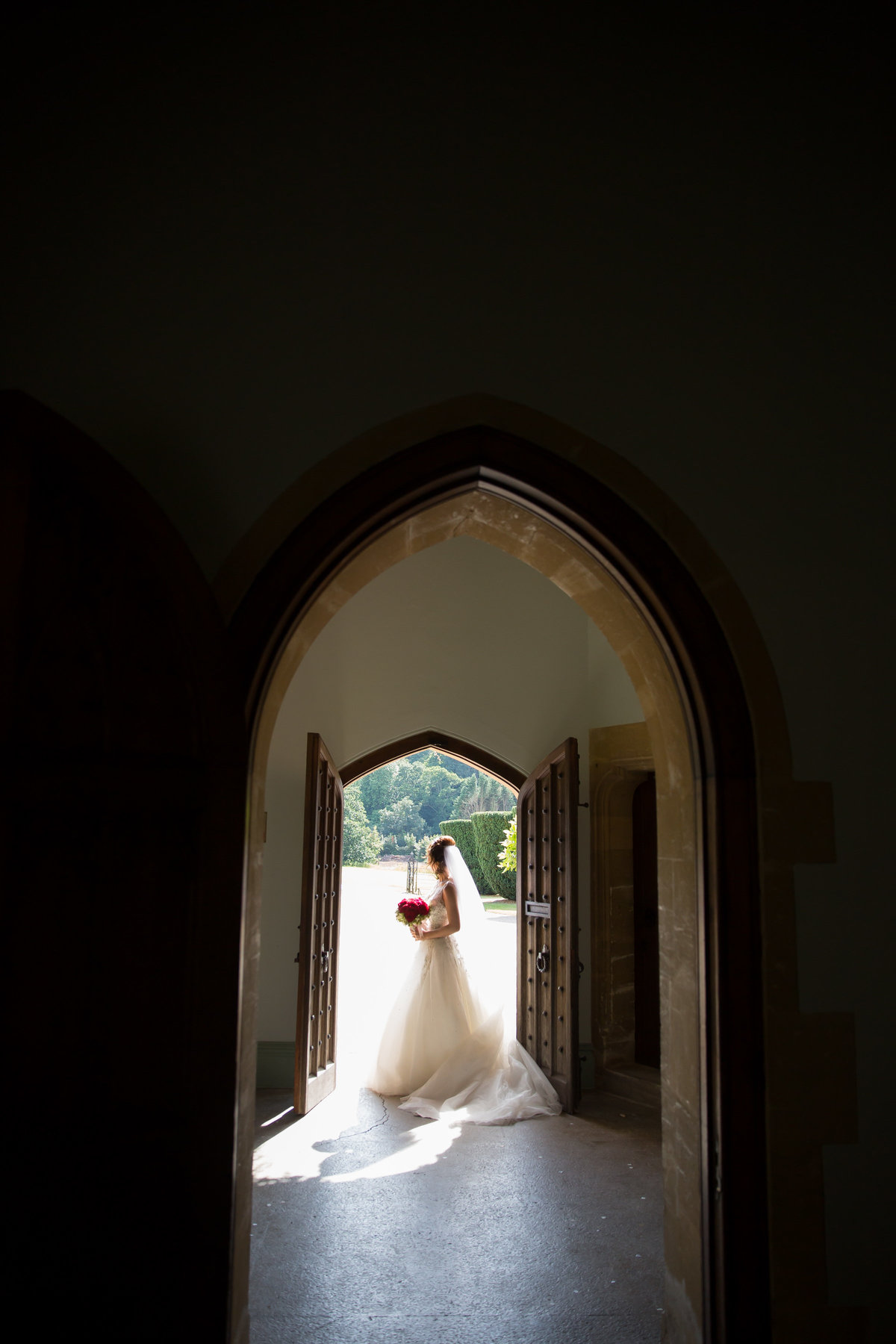 bride in doorway at st audries park somerset